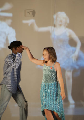 "Alyson Cavazos, 9, of Federal Hill, acting as Sharpay Evans dancing with Rodrick Brown, 11, of Mondawmin, acting as Troy Bolton, in the number ""Bop to the Top."""