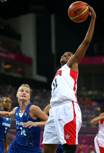 Swin Cash #11 of United States grabs the ball alongside Florence Lepron #10 of France in the second half during the Women's Basketball Gold Medal game on Day 15 of the London 2012 Olympic Games at North Greenwich Arena on August 11, 2012 in London, England.