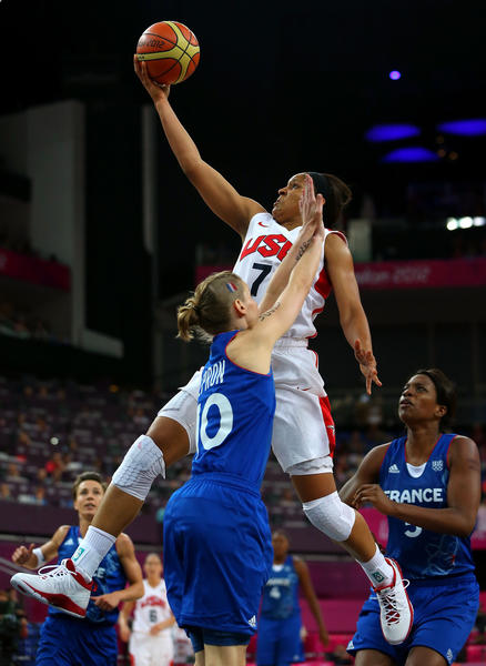 Maya Moore #7 of United States goes up for a shot against Florence Lepron #10 of France in the second half during the Women's Basketball Gold Medal game on Day 15 of the London 2012 Olympic Games at North Greenwich Arena on August 11, 2012 in London, England.