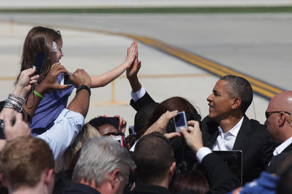 President Barack Obama meets with a small crowd of supporters after arriving at OHare International Airport Saturday.