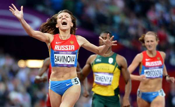 Russia's Mariya Savinova celebrates winning the gold medal as she crosses the finish line in the women's 800-meter race.