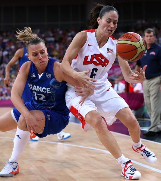 Sue Bird of the United States is harassed by  Marion Laborde of France in the first half.