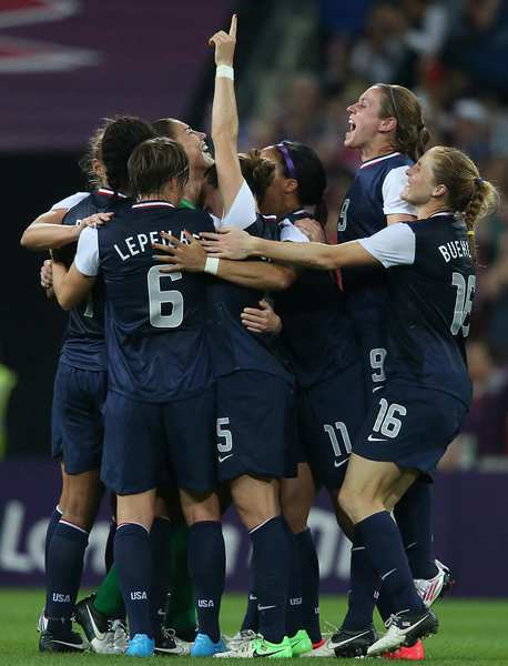 The women's soccer team avenged their loss in the World Cup with a 2-1 victory over Japan. It was the third consecutive gold medal for the American team.