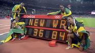 LONDON -- Usain Bolt charmed the world during the Olympics and won his third gold medal Saturday by anchoring a world-record 400-meter relay performance, but still he was denied one prize.