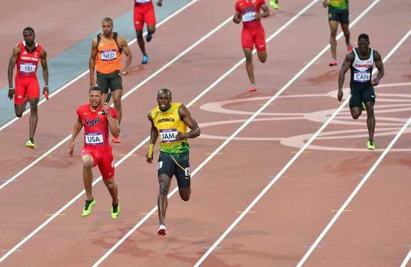 Jamaica's Usain Bolt, center, outpaces Ryan Bailey of the United States in the anchor leg of the men's 4x100-meter relay final.