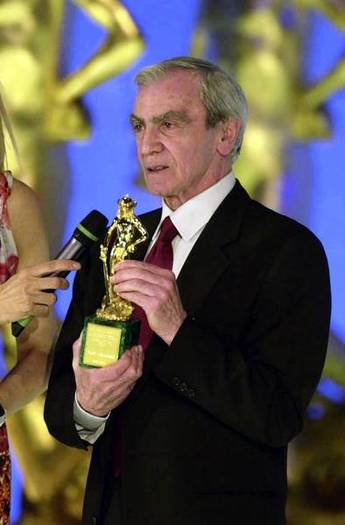 Carlo Rambaldi with an Italian David Di Donatello cinema award.