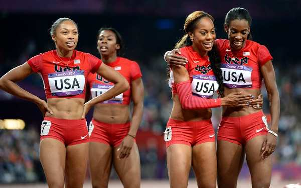 United States runners, from left, Allyson Felix, Francena McCorory, Sanya Richards-Ross and DeeDee Trotter celebrate after winning gold in the women's 4x400 relay.