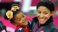 LONDON — On the floor of North Greenwich Arena late Saturday night after the U.S. women's basketball team blasted France 86-50 in the Olympic final, Candace Parker wrapped 3-year-old daughter, Lailaa, in her arms and kissed the girl on the cheek.