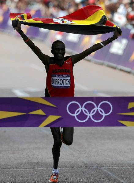 Uganda's Stephen Kiprotich celebrates as he crosses the finish line to win the men's marathon.