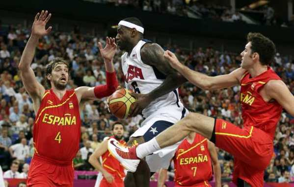 LeBron James drives between Spain's Pau Gasol and Rudy Fernandez during the men's gold-medal basketball game.