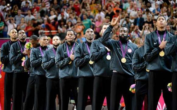 The United States' basketball team pose on the podium during the medal ceremony for the Men's Basketball gold medal game against Spain.