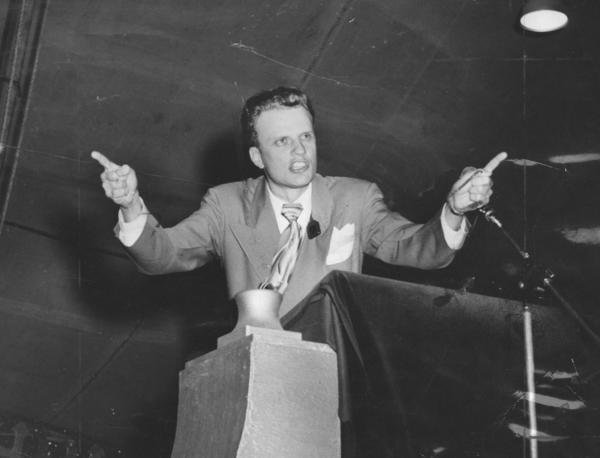 Billy Graham delivers a sermon in downtown Los Angeles in 1949, part of a two-month tent revival that drew 350,000 people and launched his meteoric rise to world-class evangelist.