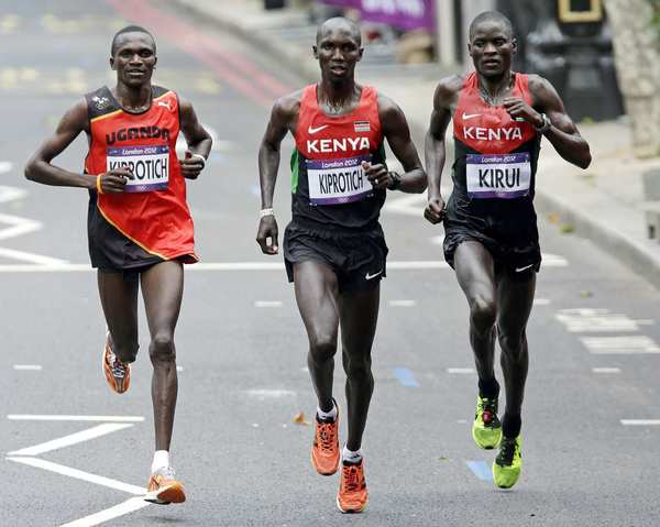 The winners, from left:  Stephen Kiprotich of Uganda, gold;  Wilson Kipsang  Kiprotich of Kenya, bronze; and  Abel Kirui of Kenya, silver.