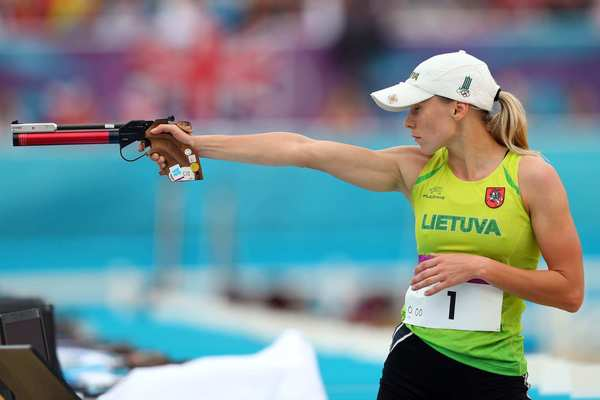 Laura Asadauskaite of Lithuania competes in the combined running/shooting event in the women's modern pentathlon on her way to a gold medal.