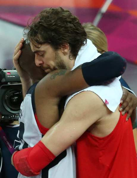 Kobe Bryant, left, and Pau Gasol embrace moments after Team USA beat Spain in the  Olympics men's basketball final. Bryant and Gasol play for the Los Angeles Lakers.