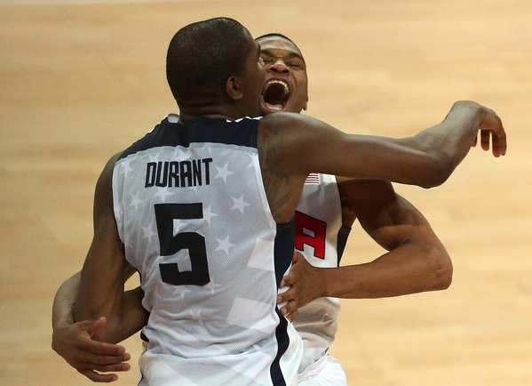 Kevin Durant and Russell Westbrook embrace after Team USA beat Spain to win the gold medal. The players are teammates on the NBA's Oklahoma City Thunder.