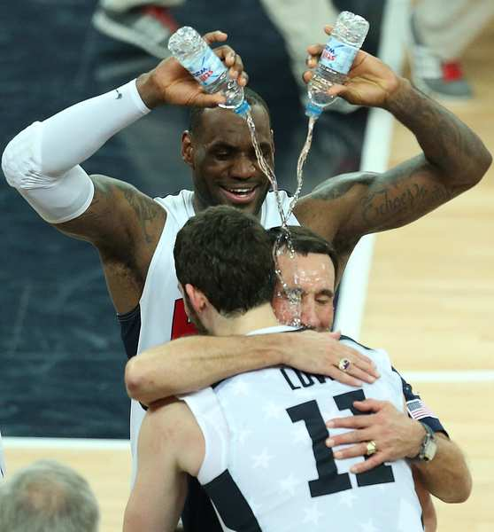 LeBron James douses  men's basketball coach Mike Krzyzewski and  Kevin Love  after the United States beat Spain to win the gold medal. Krzysewski said this was his last Olympics.