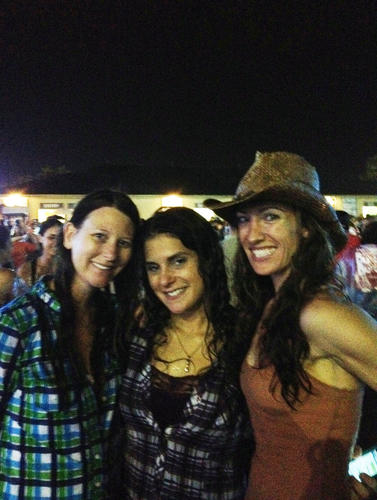 Cowboys and cowgirls tried to keep dry during the rainy Jason Aldean concert at Cruzan Amphitheater
