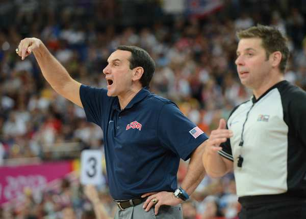 U.S. men's basketball coach Michael Krzyzewski, left, directs his players during the basketball final against Spain. Krzyzewski says this was  his last Olympics.