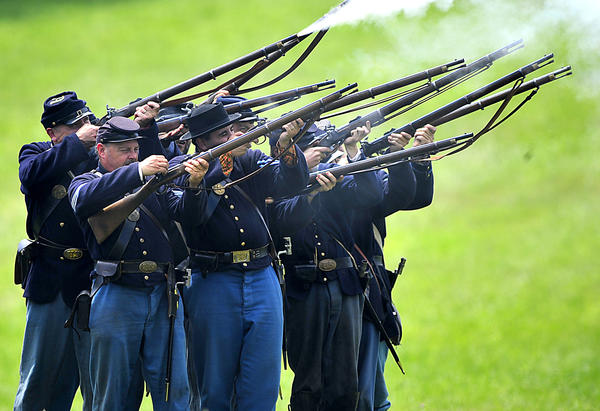 Union re-enactors fire weapons Sunday during a mock Civil War battle at Renfrew Park in Waynesboro, Pa.