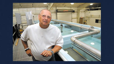 Chris Meyer poses for a photograph inside the Somerset County Water System treatment plant. Meyer lives with his wife, Linda, a college professor from Shanksville, and three golden retrievers in Indian Lake.