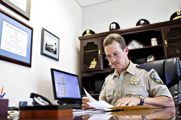Sheriff Mark Marshall works at his office in Isle of Wight County on Aug 2.