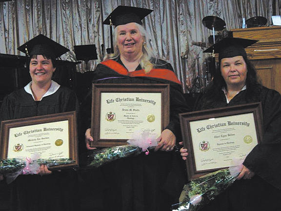 From left, shown with their diplomas are Michelle Lee Gordon, who graduated magna cum laude with an advanced diploma in theology; Drista M. Stultz, who graduated summa cum laude with a Master of Arts in theology; and Cheri Lynn Belton, who graduated summa cum laude with a diploma in theology.
