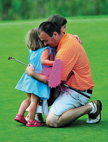Steve Ligi gets hugged by his daughters, Addison and McKenzie, after winning the 29th WACO Championship at Beaver Creek Country Club on Sunday.