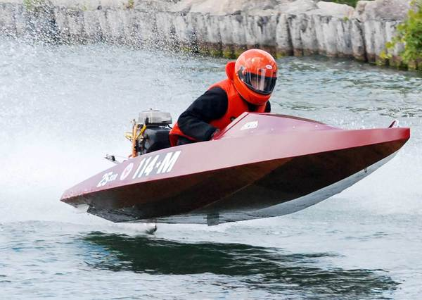 Rob Wilkins of Indian River powers his Class 25SSR Stock Runabout down Indian River Sunday at the Top O' Michigan Outboard Marathon Nationals near DeVoe Park in Indian River. Wilkins captured his first national title since 2001.