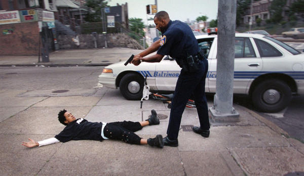Police Officer Raymond Cook arrests 16-year-old Lance Tate on an armed carjacking charge at the corner of Edmondson Avenue and Allendale Street on June 6, 1997. Weeks later Tate was shot to death in what police called a fight between rival gangs.