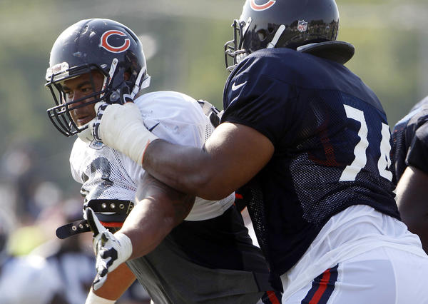 Chicago Bears defensive tackle Stephen Paea (left) battles offensive tackle Chris Williams during training camp.