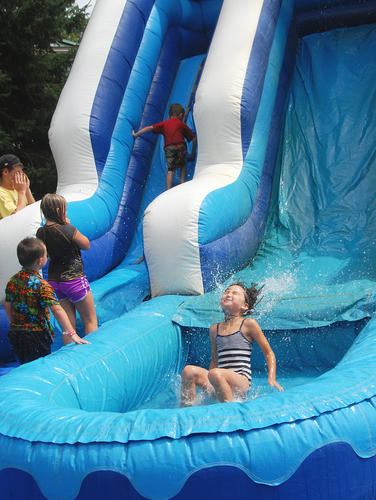 Claire Ranney, 7, of Harbor Springs gets wet on the waterslide.