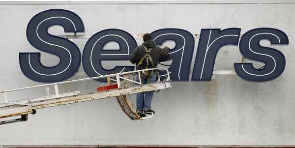 Sears Holdings said it will move ahead with plans to split off its Hometown and Outlet stores.