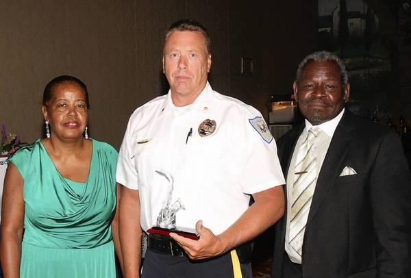 Laurel Police Maj. Keith Mapp (center) accepted a Merit Award on behalf of Laurel Police Chief Richard McLaughlin at the Mance Foundation's Evening of Jazz and Awards Dinner Benefit July 21. Mance Foundation founder and president is Patricia Daniels (left). At right is Daniels' husband, Willie Daniels.