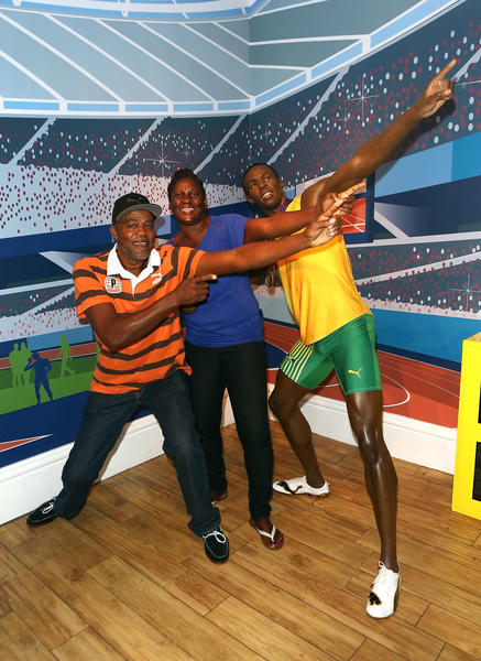 Wellesley Bolt and Jennifer Bolt visit the wax figure of their son Usain Bolt after his triple gold London 2012 Olympic success at Madame Tussauds on August 13, 2012 in London, England.