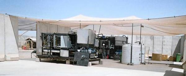 The Tactical Garbage to Energy Refinery (TGER) 1.0 system prototype underwent field testing at Camp Victory, Iraq, where it was exposed to unforgiving 120 degree temperatures and sand storms.
