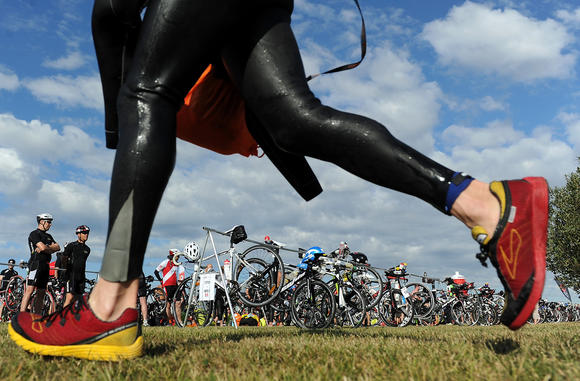 A competitor runs through transition during the iron distance triathlon
