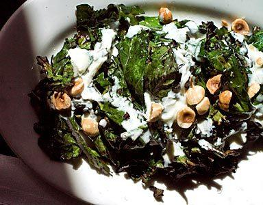 Grilled Russian kale with yogurt dressing and toasted hazelnuts.