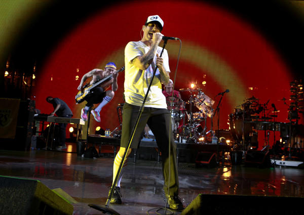 "Lead vocalist Anthony Kiedis performs with bassist Michael ""Flea"" Balzary and drummer Chad Smith."