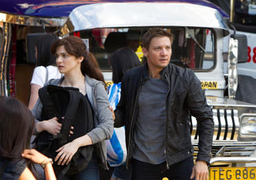 "This film image released by Universal Pictures shows Rachel Weisz as Dr. Marta Shearing, left, and Jeremy Renner as Aaron Cross in a scene from ""The Bourne Legacy."""