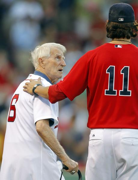 Boston Red Sox legend Johnny Pesky (L) looks up to Boston Red Sox pitcher Clay Buchholz during pre-game ceremonies before taking on the Toronto Blue Jays in a MLB American League baseball game at Fenway Park in Boston, Massachusetts August 20, 2010.