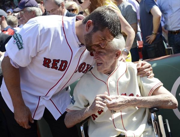 In one of his final public appearances, Johnny Pesky received a hug from Jason Varitek on April 20, 2012 as the 100th anniversary of Fenway Park was celebrated.