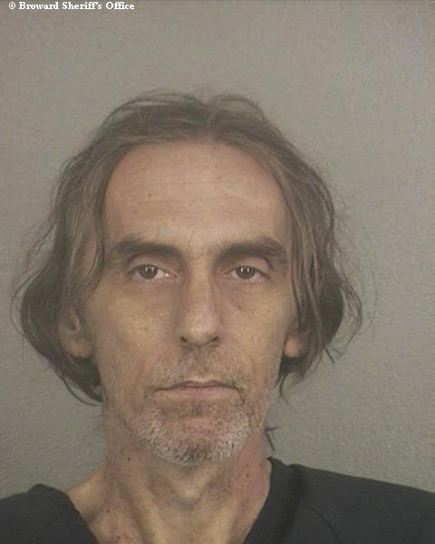 Darin MacDannald, 47, was charged after a 14-year-old boy, weighing only 85 pounds, was rescued from his burning mobile home in Deerfield Beach