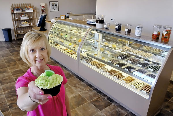 Cindy Long is shown at the former location of Cindy's Sweets & DeLite-ful Treats at Valley Mall in Halfway. The dessert shop at Valley Mall in Hagerstown, reopened with a store inside the mall last week after being housed in the food court since July.