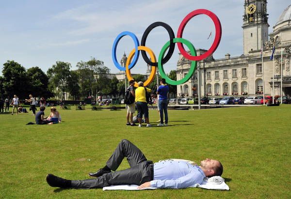 Photos: The 2012 London Olympics: A man has a quiet nap outside Cardiff Town Hall before Brazils London 2012 Olympic games football match against Egypt at the Millennium Stadium in Cardiff, Wales on July 26, 2012.