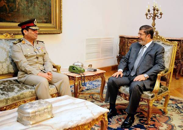 Egypt's president broadens his powers with military purge.