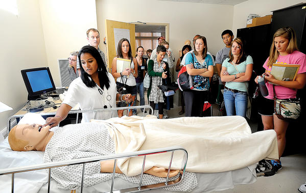 Melissa Hanky, vice president of the Towson University nursing program graduating senior class at Hagerstown, introduced SimMan to some of the incoming nursing students Monday morning in the lab at the University System of Maryland at Hagerstown.
