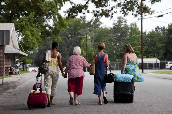 "Women from Yemassee, S.C., walk to the train in the new Lifetime series, ""The Week the Women Went."""