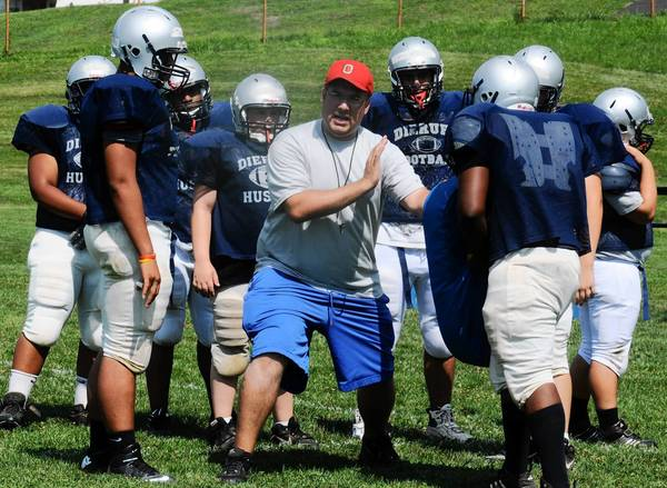 Dieruff assistant coach John Truby instructs a group of players during practice Monday.