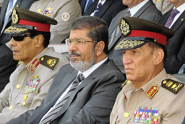 President Mohammed Morsi, center, forced out Field Marshal Hussein Tantawi, left, who led the military council that ruled Egypt for more than a year, and Lt. Gen. Sami Anan, right, the armed forces chief of staff.